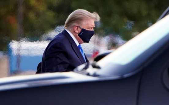 Trump, stricken by COVID-19, flown to military hospital