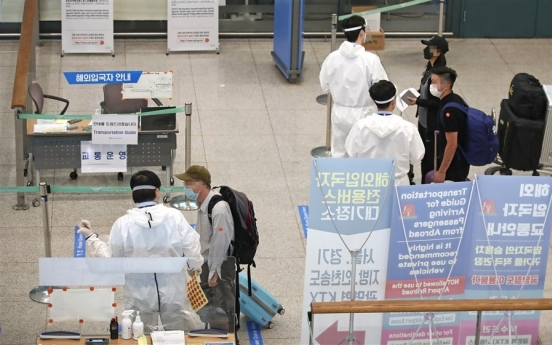 China-bound passengers must submit 2 negative COVID-19 test results