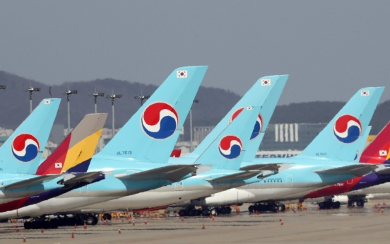 Ministries to discuss Korean Air's plan to buy rival Asiana