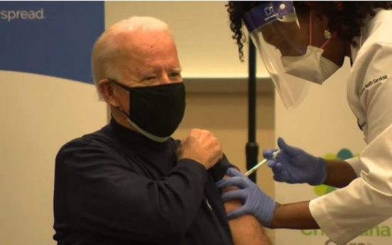 Biden gets vaccinated for COVID-19, tells people to follow suit