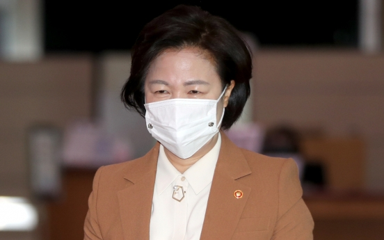 Justice minister apologizes over massive virus outbreak at detention center