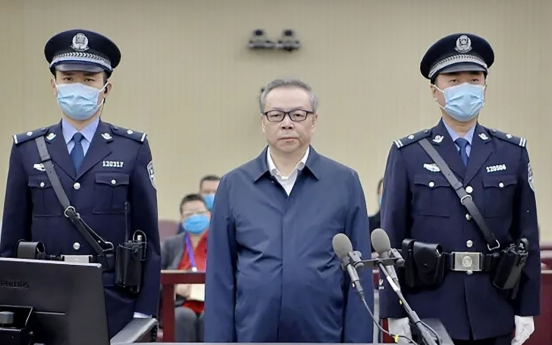 Former head of China state asset firm sentenced to death