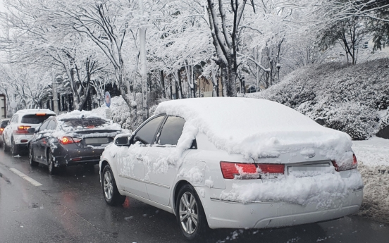One killed, dozens injured in traffic accidents amid heavy snow