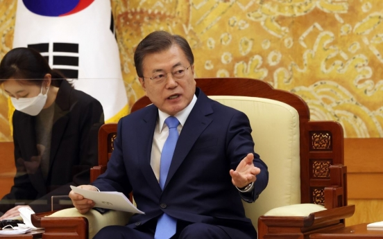 Moon vows efforts to improve Japan ties in talks with Biden aides