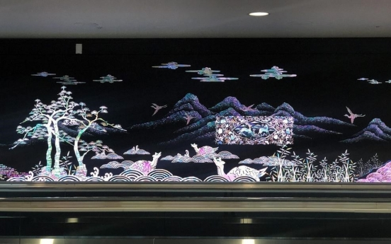 Media artwork with traditional Korean themes greet arrivals at Incheon Airport