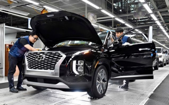 Carmakers' March sales rise 12% on robust overseas demand
