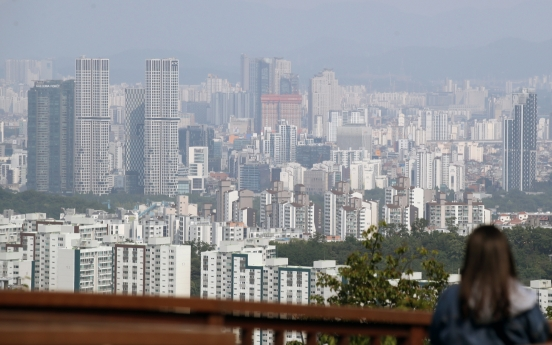 Finance minister warns of adjustments in home prices