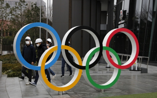 Tokyo elects assembly amid pandemic fears over Olympics