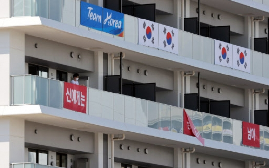 S. Korea takes down banners at athletes' village on IOC's request
