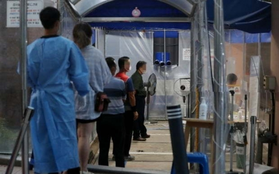 Korea sees record daily cases despite toughest distancing rules