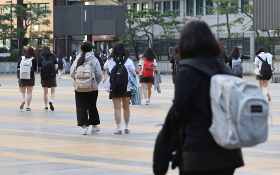 School children return to classrooms from summer vacations in middle of raging pandemic
