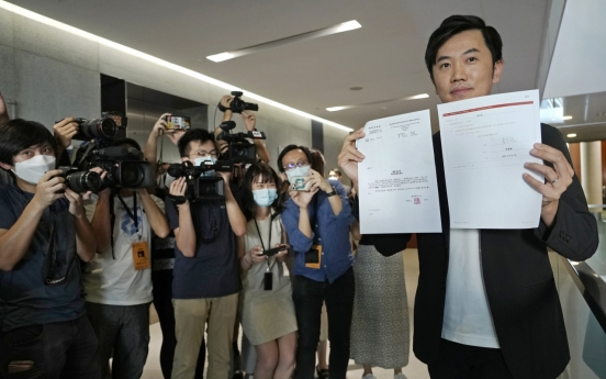 Hong Kong 'patriot' committee removes opposition lawmaker from office