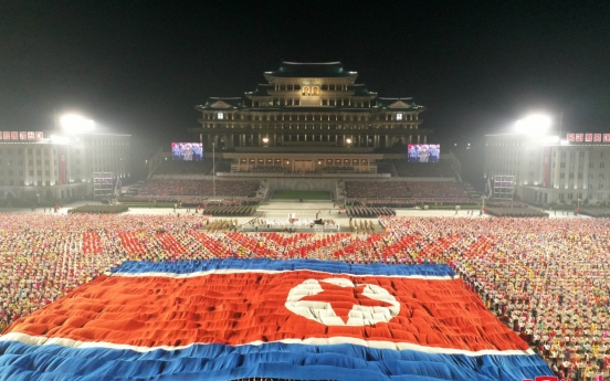 NK holds parade without missiles amid nuclear standoff