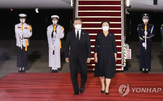 Moon back in Seoul with war remains from US