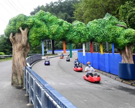 Closed road reborn as world's longest box car race track