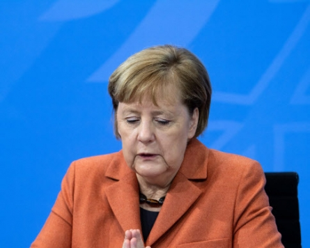 German virus deaths top 40,000 as Merkel warns of 'hardest weeks'