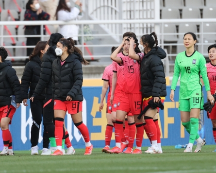 Women's football coach says Olympic dream not over yet despite loss to China