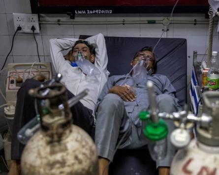 India virus cases spiral as Baghdad hospital blaze kills 82