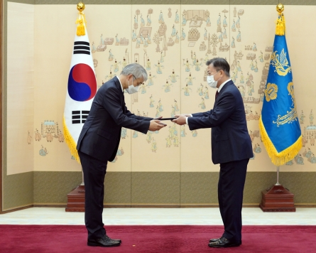 Moon presents new Supreme Court justice with letter of appointment