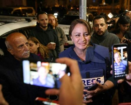 Israel arrests Jerusalem activist as reporter recovers