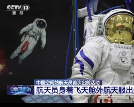 Chinese astronauts make first spacewalk outside new station