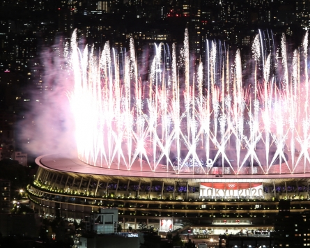 Troubled by pandemic, Tokyo Olympic Summer Games open with scaled-back ceremony