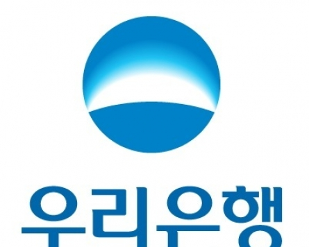 Fitch raises Woori Bank's credit rating to A