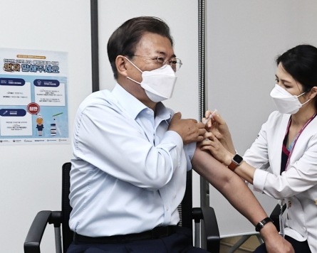 President Moon, first lady receive COVID-19 booster shots