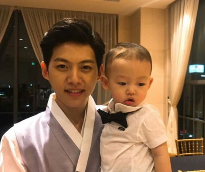 Former U-Kiss Member Shin Dong-ho Holds Son's First